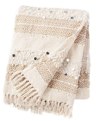 """MOROCCAN WEDDING BLANKET—This bohochic textile marries Old-World tradition with modern style. """"It's made by hand and woven with different textures, usually in a striped pattern,"""" says Denham. """"Often, it will have silver sequins, too."""" Use it as a throw, bed covering or wall hanging.Look for it at: KechmaraDesigns, 1104 R St."""